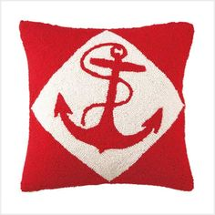 This attractive nautical hook pillow adorned with a red anchor and red background will enhance your nautical decor.