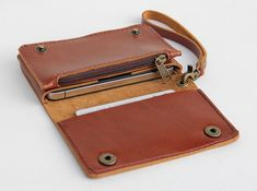 Leather iPhone wallet case with mini zipper in caramel brown