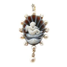 ANTIQUE AGATE CAMEO  ENGLAND  19th Century  PEARL, DIAMOND, AND AGATE DIAMOND PENDANT DEPICTING A CHERUB PLAYING A PIPE, FRAMED BY OLD MINE CUT DIAMONDS AND PEARLS. (PEARLS NOT TESTED)