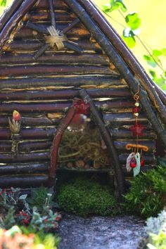 Juise: Our Fairy Garden: A Tour - a lovely fairy garden - site has tutorials on lots of the elements they've build over years - I especially love the details of house front, and the glass pebbles in the little pond are perfect, rope ladder, nest in tiny tree, some nice inspiration