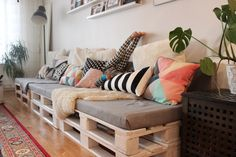 Our livingroom with diy sofa made by wood pallets.