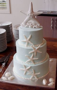 Beach Theme Wedding Cake But with theme colors as the star fish, no top starfish