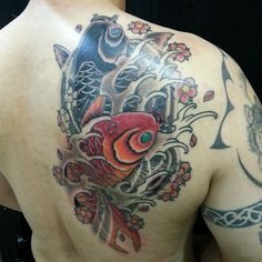 Japanese Koi tattoo. For further inquires contact Victor at…
