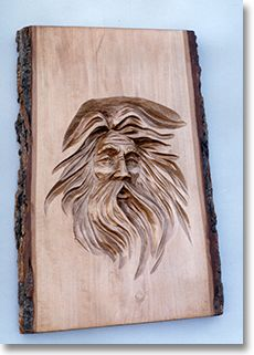 Woodspirit Carving in a Log by Peter Newton - He calls them Wizards or Spirit Faces (These are woodcarving ideas)