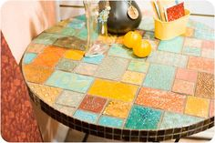I want to try this and another pinner said:Table with metal tiles that were embossed in the Big Shot.  From the Sizzix CHA Summer 2011 booth and Scrapbook Update.  Awesome!