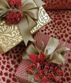 Carolyne Roehm- gifts wrapped with beautiful paper, satin ribbon & dried or silk flowers