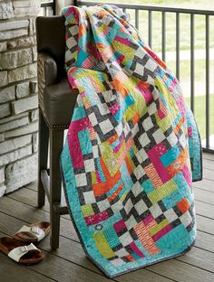 "The Sassy Sister quilt, by Rachel Hayes, uses 2½"" precut strips to create an Irish Chain effect. This patchwork design is a scrap quilt pattern lovers delight!"