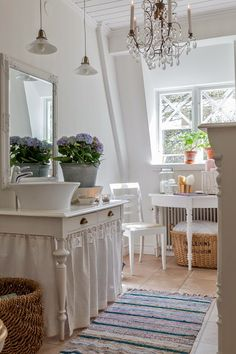 Skirted table for storage, maybe this is a vanity of some sort or storage in an older bathroom area?  Pretty though!