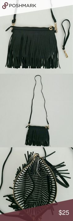 "Fringe Crossbody Bag @blushonme at Poshmark   Fringe Crossbody Bag   Featuring a vegan leather crossbody bag that can also be use as a wristlet. Fringes on both sides. One main compartment with side zipper, and side open slot. Detachable straps.   ALSO AVAILABLE IN BLUE, BLUSH PINK, AND WHITE!  Approx Measurements -  Length - 5 3/4"" Width - 2 3/4"" Across - 8"" Shoulder strap drop - 24.5""  ● PRICE IS FIRM ● Bags Crossbody Bags"