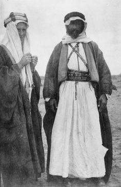 T.E. Lawrence, wearing Arab dress, in conversation with Auda abu Tayi, leader of the Howeitat tribe, in the desert