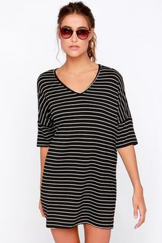 LuLu*s Exclusive! For a casual cute dress you can wear over and over (and over and over!), get the Repeat After Me Black Striped Dress! This stretch knit dress has a relaxing shift shape, topped with a V neckline and short sleeves. Thin white lines bring extra style to keep it repeat worthy. Unlined. 96% Rayon, 4% Spandex. Dry Clean Only. Made With Love in the U.S.A.