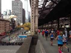 Photos: Scenes From The NYC Marathon Course - Competitor Running