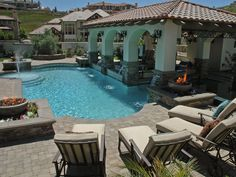 Spanish style pool, swim up bar and patio