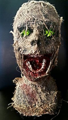 Check out this item in my Etsy shop https://www.etsy.com/listing/243084508/halloween-prop-burlap-head-light-up-eyes