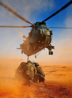 Royal Marines from the Commando Mobile Air Operations Team conducting load lifting operations with a SeaKing Mk4 helicopter from 845 Naval Air Squadron during Exercise Pashtun Commando in Jordan.