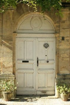 I think a front door of a house often sets the tone for the rest of the home. A beautiful door and surroundings makes the visitor look forwa. The Doors, Entrance Doors, Doorway, Windows And Doors, Door Entry, French Country House, French Farmhouse, French Country Decorating, Portal