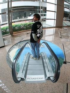 Street Art 3D Optical Illusion | Optical illusion of a man going down into the earth on escalator.