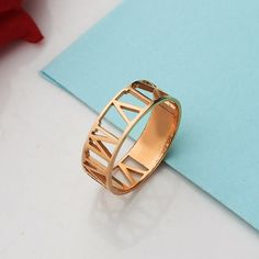 Rose Gold Roman Numeral Ring. Personalized by Lovenamejewelry