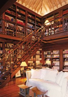 This rustic home library has gorgeous two stories of floor to ceiling bookshelves. Take your vintage decorating ideas to a whole new level!