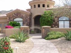 courtyard wall - Stucco wall with rustic stone columns