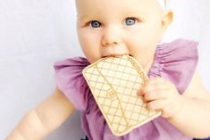 Designer handbag wooden teethers! So clearly 6 months old is the perfect age for your first Chanel or Celine.
