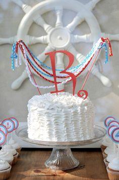 Nautical ruffle cake with korker ribbon cake bunting