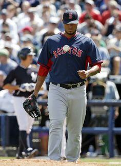 Boston Red Sox starting pitcher Felix Doubront tosses the ball up after allowing a bunt single to New York Yankees Brett Gardner in the second inning of a spring exhibition baseball game in Tampa, Fla., Tuesday, March 18, 2014. Doubront allowed four runs to the Yankees in the second inning. (AP Photo/Kathy Willens)
