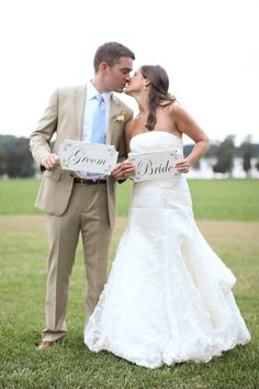 Adorable signs for the bride and groom.  Photo by Aaron Snow Photography.  www.wedsociety.com  #wedding #cutecoupels
