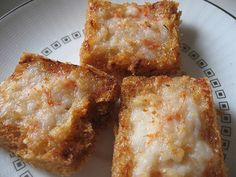 Original Shrimp Toasts or Shrimp Squares  Ingredients: shrimps (mince to paste form), some salt and pepper, bread cut into squares  Directions: Slather the minced shrimps on the surface of the bread; deep fry in medium-hot temperature oil till shrimp filling at the top changes color