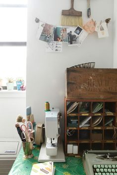 Clothespinned photos and antique post office boxes as organizer