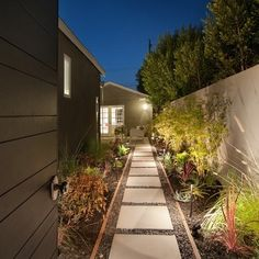 Side of house. Timber edging with large format pavers and gravel. Economic option to total pave.