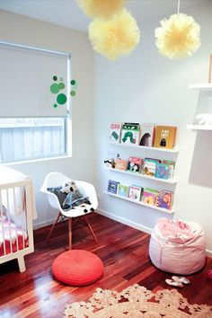 Name: Ruby (2) Location: Mornington Peninsula, Victoria, Australia Room Size: 10' x 12', 120 sq ft How to make a minimalist nursery still feel fun and inviting? Add color, texture, and a dash of whimsy. That's exactly what Ruby's mom, Danielle, did when she designed this space. The clean and simple design lends itself to easy changes as Ruby grows, while the hand woven hemp rug, crocheted pouf, colorful accessories, and wood floors add warmth and character to the space.