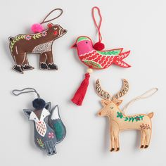 Our set of embroidered forest animal ornaments includes a brown bear, a green bird, a gray fox and a brown deer. Handcrafted of fabric and finely stitched, this quartet of critters features intricate patterns and floral embellishments inspired by folk art.