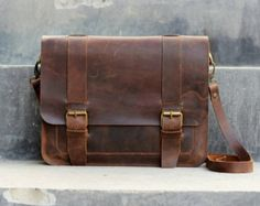 Messenger Bags, backpacks and satchels are all good. I like leather but cloth would do nicely too to add variety. Just make sure cloth things stay in the color scheme.