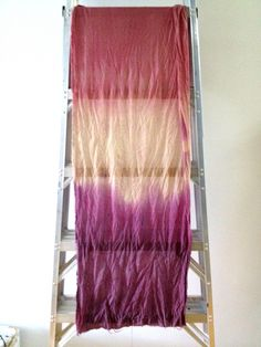 table runner dip-dyed with natural elements like hibiscus flowers & berries