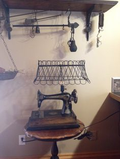 Lamp made from an old treadle Singer sewing machine. Primitive upcycled repurposed creations.