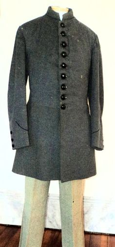 Confederate Enlisted Frock Coat. Early War enlisted men's frock coats are the rarest existing form of the Confederate uniform coat. Although the frock coat was prescribed for enlisted men by the earliest regulations, they were soon superseded by the short shell jacket to conserve cloth. This example is a cadet grey, single breasted, frock coat; not only does it have infantry branch of service colored piping around the collar, it also has regulation pointed cuffs, they too in infantry blue.