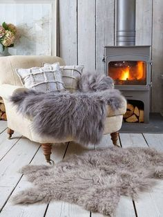Woodburner, cosy airmchair and wool rugs