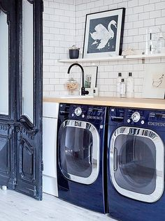 Love this navy and white laundry room with classic subway tiles, a butcher block counter and leaning gallery wall on the open shelves. White Laundry Rooms, Laundry Closet, Laundry Room Storage, Small Laundry, Laundry Room Design, Laundry Area, Classic White Kitchen, Laundry Room Inspiration, Ikea