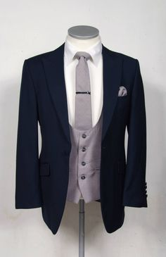 Royal blue slim fit suit with ascot grey scooped waistcoat wedding suits for grooms to hire or purchase. www.anthonyformal... #wedding #groom #suit #anthonyformalwear #suithire #navy