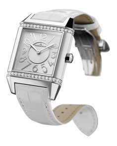 Feminine yet sporty - @jlcwatches Reverso Squadra Classic watch offers a touch of glamour. #luxurywatches Price - £5,500. Shop the look: http://www.thejewelleryeditor.com/window-shopping/watches-for-her/jaeger-lecoultre-reverso-squadra-classic-watch/