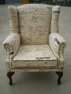 jaro wing chair upholstered in popular revenge fabric this one has black piping studs and cabriole legs as its features