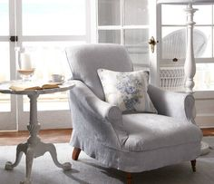 Ralph Lauren Rosecliff Collection - comfy reading seat; cushy pillow; delicate white side table.