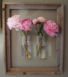 "Use a Hobby Lobby ""barn wood"" frame to surround wall mounted vases!"