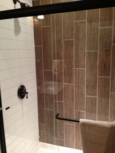wood tiles in shower bathrooms with vertical tile vertical tiles subway tile tile shower vertical tile bathroom tiles shower floor tile wood look tile shower ideas Wood Look Tile Bathroom, Wood Tile Shower, Wood Wall Tiles, Wall Tiles Design, Master Bathroom Shower, Bathroom Ideas, Bathroom Showers, Tile Showers, Bathroom Faucets