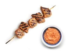 Anne's Pork Kebabs are served with romesco sauce. Tomatoes, piquillo peppers, almonds and sherry vinegar come togther in a textured, tangy sauce you could eat all by itself.