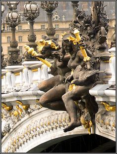 Paris ~~Pont Alexandre-III with its exuberant Art Nouveau lamps, cherubs, nymphs and winged horses was built between 1896  and 1900. It's named after Tsar Alexandre III. The style of the brdige reflects that of the Grand Palais, to which it leads on the right bank.
