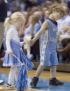 Let's go UNC. young lovers at a heels game.