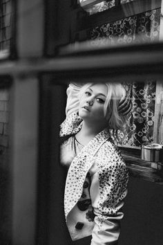 elle king is a banjo-playing badass with tattoos and a soft side.