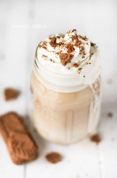 biscoff caramel macchiato with whipped cream & crumbled lotus biscuits